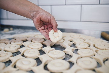 Procedure of making donuts in a small town donut bakery. Selective focus.