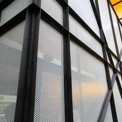 Perforated sheet of metal texture and black steel background