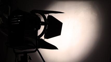 Big studio lighting with tripod for video production.