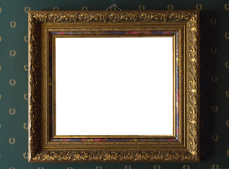 Gilded picture frame on the background of a vintage wall