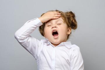 Sad little girl with headache