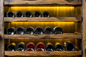 wine bottles on wooden shelves