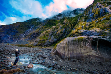 traveling man take a photograph in franz josef glacier important traveler destination in south island new zealand