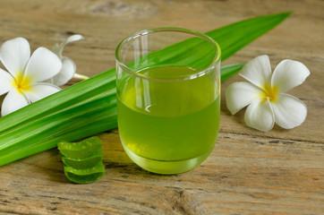 Aloe vera and pandan juice on wooden background