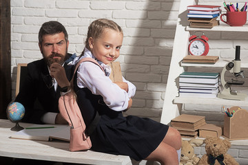 Education and family concept. Daughter and father in classroom