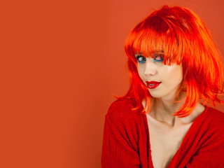 woman with orange hair wig and fashionable makeup