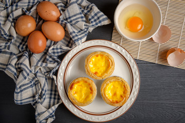 egg tart on black wood