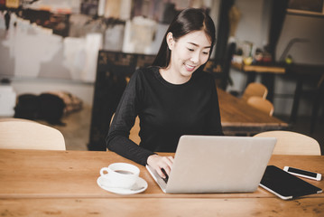 Business asian young women using tablet computer to work with financial data in the work space. Business Concept.