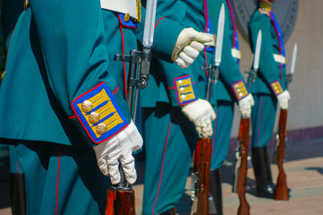 Soldiers in parade uniform with rifles and bayonets