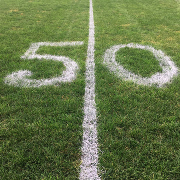 A Fifty Yard Line Painted On A Grass Football Field