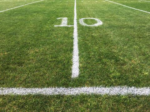 A Ten Yard Line Painted On A Grass Football Field
