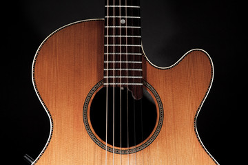 Roundback acoustic guitar with rosette purfling and extended fingerboard in close up.
