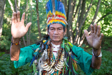 Man in authentic costume posing in woods