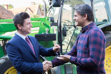 Farmer Collecting Keys To New Tractor