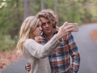 Couple Taking Autumn Selfies