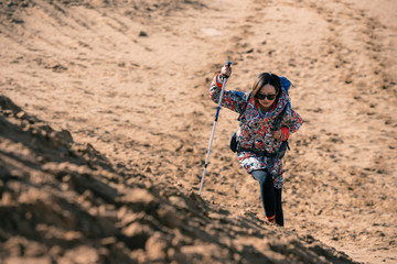 Young girl traveling on a desert