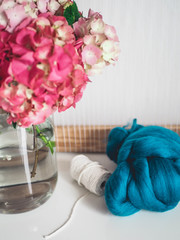 Pink hortensia in a big jar on a white table