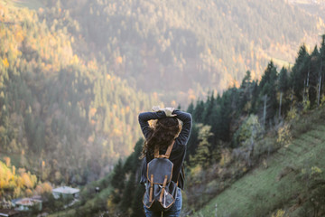 A girl with backpack admiring view