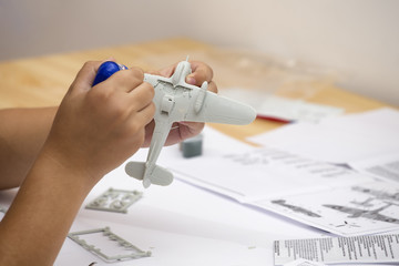 Boy gluing plastic model kit