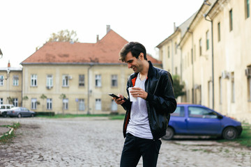 Man smiling and looking at his smart phone