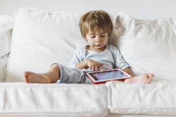 1 year old boy looking a digital tablet