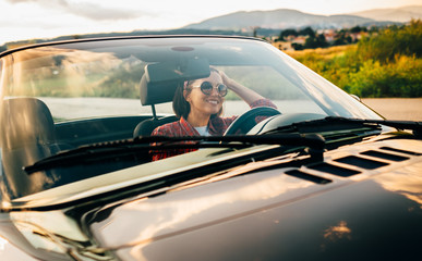 Woman drive cabriolet car: sunset time, mountain province road