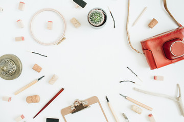 Layout with copy space made of retro camera, succulent, tools for handmade arts, clipboard on white background. Top view, flat lay hipster artist concept.