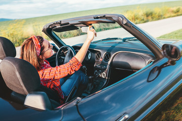 Woman drive a cabriolet car