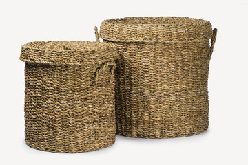 SET OF TWO LARGE ROUND NATURAL PLANT FIBRE BRAIDED BASKET WITH HANDLES AND LID ISOLATED ON WHITE BACKGROUND