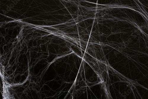 halloween decoration of spider web over black