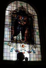 A woman prays in the Basilica of Los Angeles in Cartago, Costa Rica
