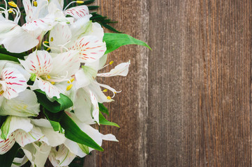 Bouquet of Lillies on Rustic  Wooden Table
