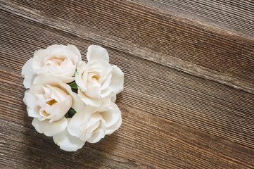 White Roses on Rustic Wooden Table