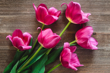 Pink Tulips on Rustic Wooden Table