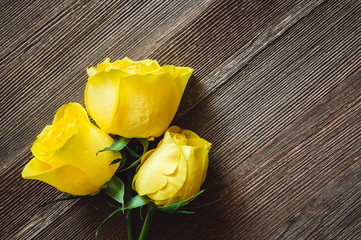 Yellow Roses on Rustic Wooden Table