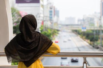 Arab or Muslim women looking with copy space