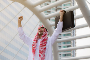Arab or Muslim business man celebrating after project complete feeling so happiness