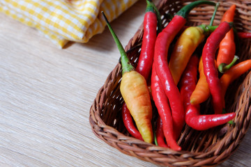 Some chilies placed on rattan basket to make some hot and spicy food