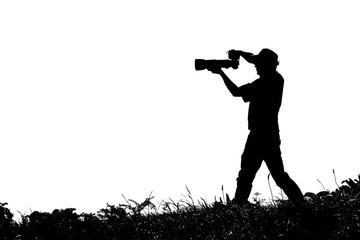 Black and white photo, silhouette of photographer in nature