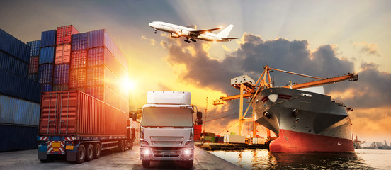 Wall Mural - Logistics and transportation of Container Cargo ship and Cargo plane with working crane bridge in shipyard at sunrise, logistic import export and transport industry background