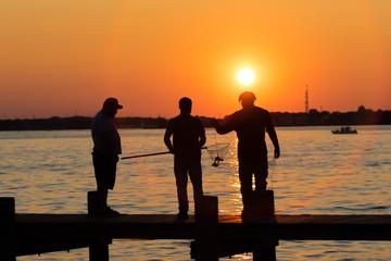 Man crabbing fishing during sunset on the boardwalk