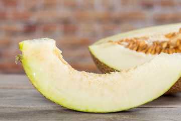Sliced melon on wooden surface