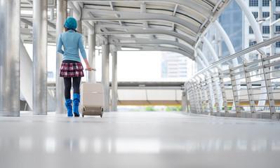travel women hold luggage travel passenger bag of tourist traveler on walk way in gate terminal.