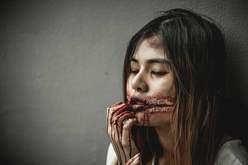 Asian woman dressed mimic zombies on Halloween. grim tone. sad tone.