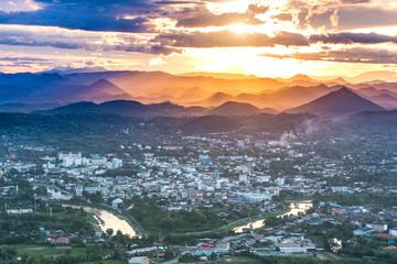 Beautiful Loei Thailand landscape with sunset in rainy season and mountain background, Cityscape with Mountain backdrop. View of the city and the river at sunset. Phu Bor Bid Loei Province Thailand.