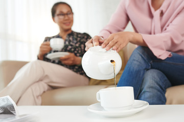 Filling cup with tea