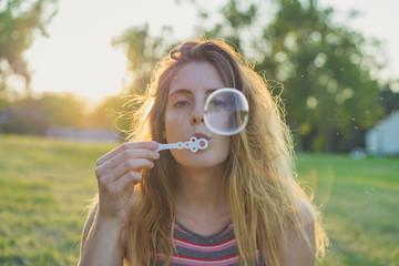 Woman making soap bubbles