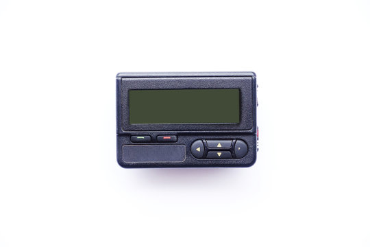 Old beeper or pager isolated on white background