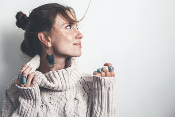 Boho jewelry and woolen sweater on model