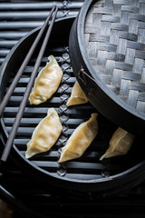 Closeup of gyoza dumplings in bamboo steamer